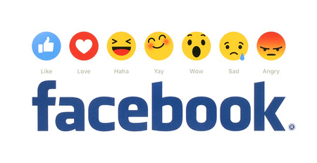 Kiev, Ukraine - February 9, 2016: New Facebook like button 6 Empathetic Emoji Reactions printed on white paper. Facebook is a well-known social networking service.