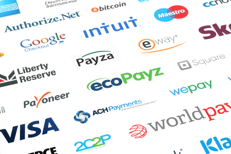Kiev, Ukraine - February 10, 2016: Collection of popular payment system logos printed on white paper:PayPal, Google Wallet, Bitcoin, Mastercard, Maestro, Skrill, JCB, Payoneer, Visa, Worldpay and other Editorial