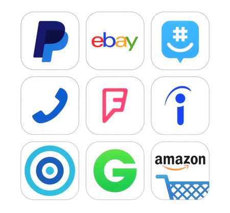 foursquare: Kiev, Ukraine - February 17, 2016: Collection of popular social networking, Finance and Shopping logo signs printed on paper: PayPal, ebay, GroupMe, Talkaton, Foursquare, Indeed, Skout and other