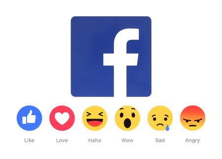 find us: Kiev, Ukraine - March 2, 2016: New Facebook like button 6 Empathetic Emoji Reactions printed on white paper. Facebook is a well-known social networking service.