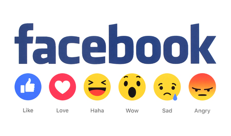 button: Kiev, Ukraine - March 2, 2016: New Facebook like button 6 Empathetic Emoji Reactions printed on white paper. Facebook is a well-known social networking service.