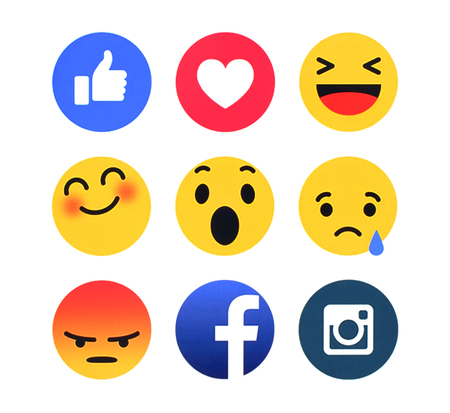 Kiev, Ukraine - March 8, 2016: New Facebook like button 7 Empathetic Emoji Reactions printed on white paper. Facebook is a well-known social networking service.