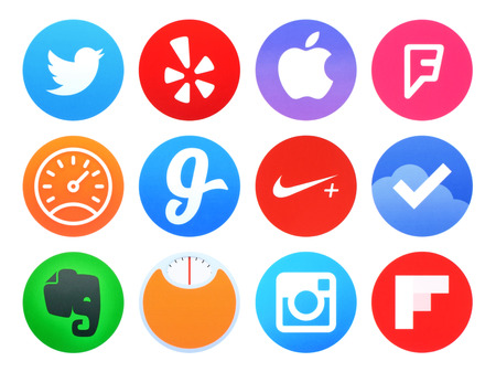 yelp: Kiev, Ukraine - April 28, 2016: Collection of popular Apple watch application icons printed on paper: Twitter, Evernote, Foursquare, Glide, Instagram, Nike running and other
