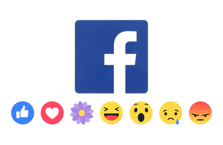 social networking service: Kiev, Ukraine - May 09, 2016: New Facebook like button Empathetic Emoji Reactions with flower printed on white paper. Facebook is a well-known social networking service. Editorial