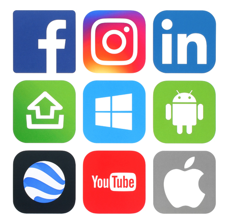 Kiev, Ukraine - May 20, 2016: Collection of popular social media, photo, video, operating system, productivity and travel logos printed on white paper.