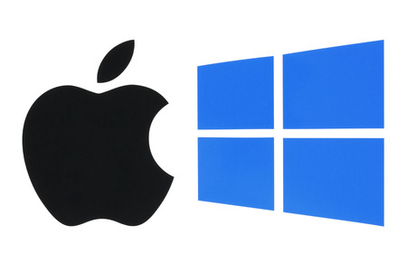 operating system: Kiev, Ukraine - June 03, 2016: Popular operating system logos printed on paper: Apple ios and Windows