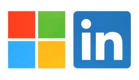 Kiev, Ukraine - June 13, 2015: Microsoft and Linkedin logos printed on white paper. Microsoft buys Linkedin social media.