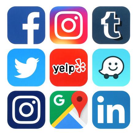 Kiev, Ukraine - July 25, 2016: Collection of popular social media, travel and navigation logos printed on paper:Facebook, Twitter, Instagram, Yelp, Google Maps, Waze, Tumblr and Linkedin