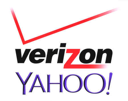 Kiev, Ukraine - July 26, 2016: Yahoo and Verizon Communications logos printed on white paper. Verizon Communications is a new owner of Yahoo services