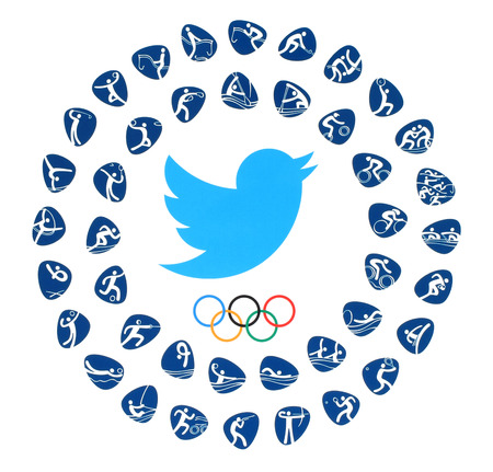 Kiev, Ukraine - August 03, 2016: Twitter bird logo with Olympic Games Rings and kinds of sport of the 2016 in Rio de Janeiro, Brazil, from August 5 to August 21, 2016, printed on paper