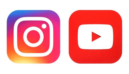 Kiev, Ukraine- July 25, 2016: Instagram new logo and Youtube icon printed on white paper 報道画像