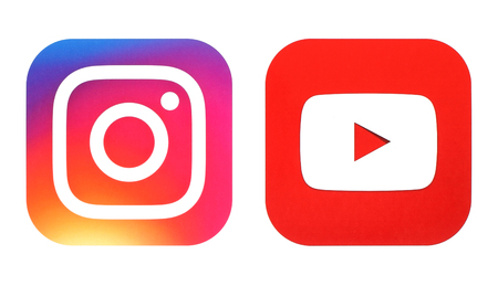 Kiev, Ukraine- July 25, 2016: Instagram new logo and Youtube icon printed on white paper Редакционное