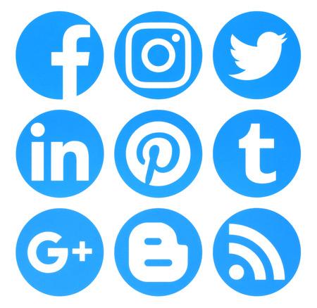Kiev, Ukraine - August 22, 2016: Collection of popular circle blue social media logos printed on paper:Facebook, Twitter, Google Plus, Instagram, Pinterest, LinkedIn, Blogger, Tumblr and RSS