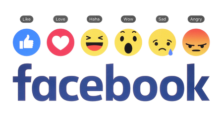 social networking service: Kiev, Ukraine - August 23, 2016: New Facebook logo with like button and Empathetic Emoji Reactions printed on white paper. Facebook is a well-known social networking service