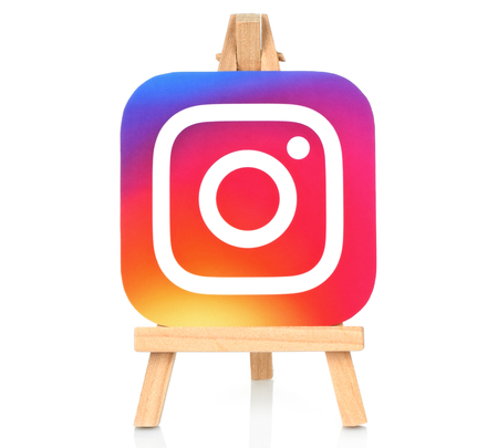 Kiev, Ukraine - August 30, 2016: Instagram icon printed on paper and placed on wooden easel. Instagram is an online mobile photo-sharing, video-sharing service