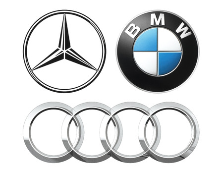 Kiev, Ukraine - September 12, 2016: Collection of popular German car logos printed on white paper: Mercedes, BMW and Audi