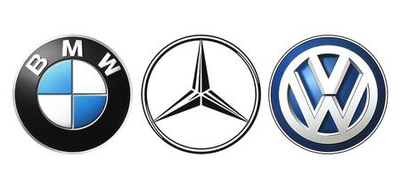 Kiev, Ukraine - September 21, 2016: Collection of popular German car logos printed on white paper: Mercedes, BMW and Volkswagen