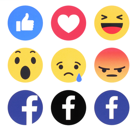 Kiev, Ukraine - November 07, 2016: New Facebook like button 6 Empathetic Emoji Reactions printed on white paper. Facebook is a well-known social networking service