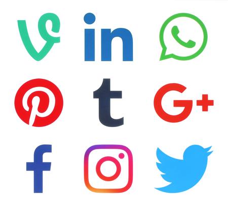 Kiev, Ukraine - November 25, 2016: Collection of popular social media logos printed on paper: Facebook, Twitter, Google Plus, Instagram, Pinterest, LinkedIn, Vine, Tumblr and WhatsApp Editorial