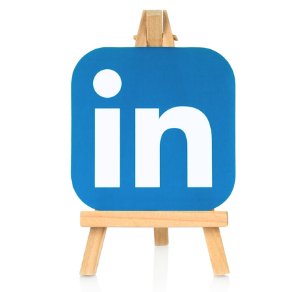 social networking service: Kiev, Ukraine - August 30, 2016: LinkedIn logo printed on paper and placed on wooden easel. LinkedIn is a well-known social networking service