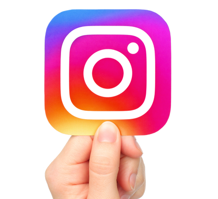 Kiev, Ukraine - January 20, 2017: Hand holds Instagram icon printed on paper. Instagram is an online mobile photo-sharing, video-sharing service Éditoriale