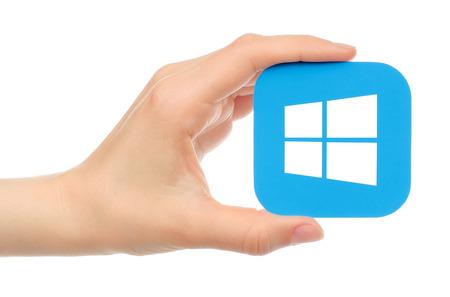 Kiev, Ukraine - May 17, 2016: Hand holds Microsoft Windows icon printed on paper