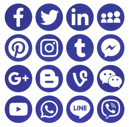Kiev, Ukraine - February 13, 2017: Collection of popular blue round social media icons, printed on paper: Facebook, Twitter, Google Plus, Instagram, Pinterest, LinkedIn, Blogger, Tumblr and others