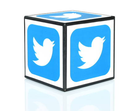 Kiev, Ukraine - September 30, 2015: Cube with Twitter icons printed on paper. Twitter is a well-known social networking and news service