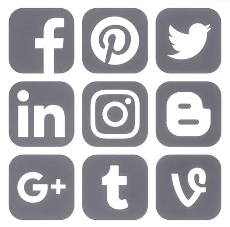 Kiev, Ukraine - March 14, 2017: Collection of popular social media grey logos printed on paper: Facebook, Twitter, Google Plus, Instagram, Pinterest, LinkedIn, Vine, Tumblr and Blogger Editorial