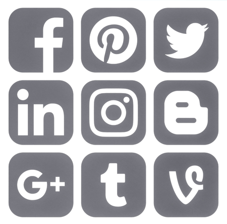 Kiev, Ukraine - March 14, 2017: Collection of popular social media grey logos printed on paper: Facebook, Twitter, Google Plus, Instagram, Pinterest, LinkedIn, Vine, Tumblr and Blogger Editorial