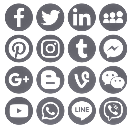 Kiev, Ukraine - April 27, 2017: Collection of popular grey round social media icons, printed on paper: Facebook, Twitter, Google Plus, Instagram, Pinterest, LinkedIn, Blogger, Tumblr and others Редакционное