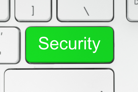 Green button with security word on the keyboard close-up