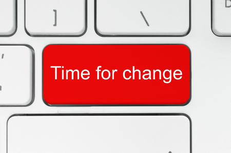 another way: Red button with time to change words on the keyboard close-up