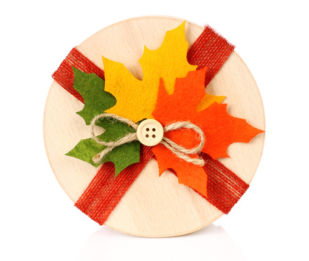 Autumn concept of present box with dried leaves on white backround