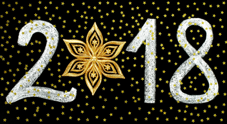 Christmas and New Year holidays concept with chalk number 2018 and stars on black background
