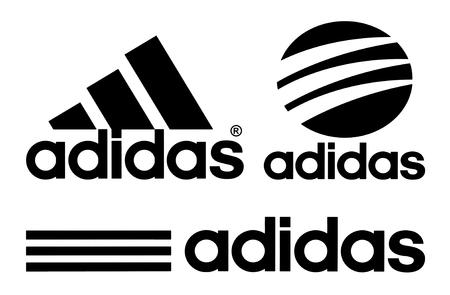 Kiev, Ucrânia - 27 de outubro de 2017: Coleção de logotipos Adidas impressos em papel branco. Adidas é uma corporação multinacional alemã, que projeta e fabrica sapatos, roupas e acessórios