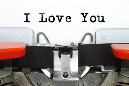 Part of typing machine with typed I Love You words close-up