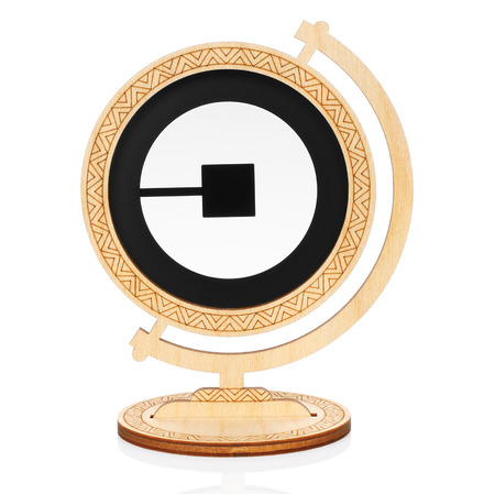 Kiev, Ukraine - November 01, 2017: Uber circle icon printed on paper and placed into wooden globe on white background. Uber is an American worldwide online transportation network company