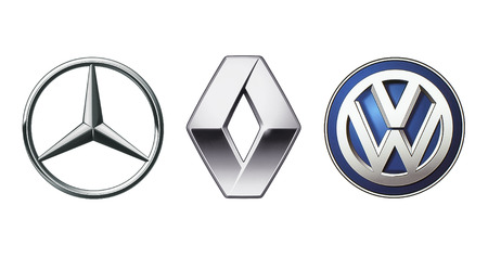 Kiev, Ukraine - November 09, 2017: Collection of popular car logos printed on white paper: Mercedes Benz, Volkswagen and Renault Editorial