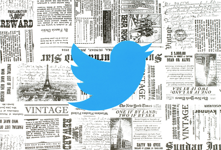 Kiev, Ukraine - January 15, 2018: Twitter logo printed on paper and placed on retro newspaper background