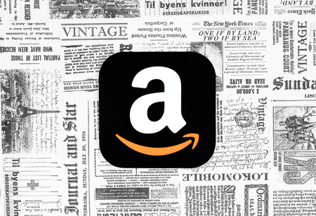 Kiev, Ukraine - February 08, 2018: Amazon icon printed on paper and placed on retro newspaper background