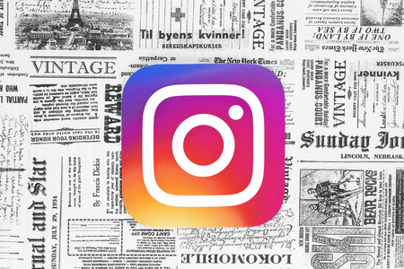 Kiev, Ukraine - February 08, 2018: Instagram icon printed on paper and placed on retro newspaper background Editorial