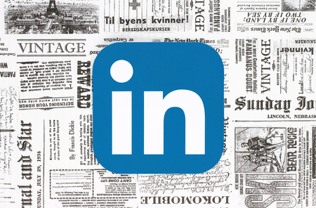 Kiev, Ukraine - February 08, 2018: LinkedIn icon printed on paper and placed on retro newspaper background Editorial