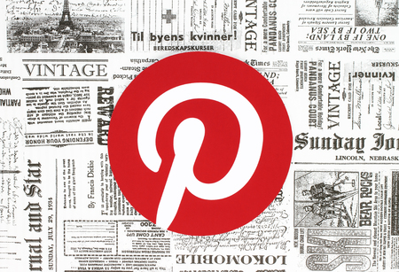 Kiev, Ukraine - February 08, 2018: Pinterest logo printed on paper and placed on retro newspaper background