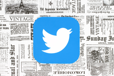 Kiev, Ukraine - February 08, 2018: Twitter icon printed on paper and placed on retro newspaper background