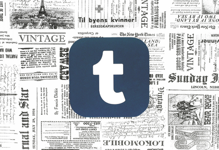 Kiev, Ukraine - February 08, 2018: Tumblr icon printed on paper and placed on retro newspaper background