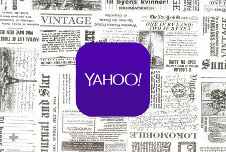 Kiev, Ukraine - February 08, 2018: Yahoo icon printed on paper and placed on retro newspaper background