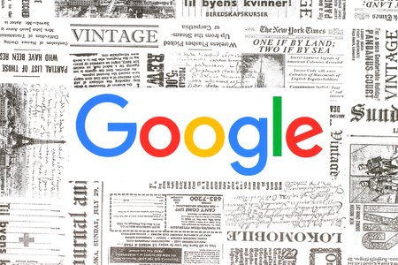 Kiev, Ukraine - February 08, 2018: Google logo printed on paper and placed on retro newspaper background