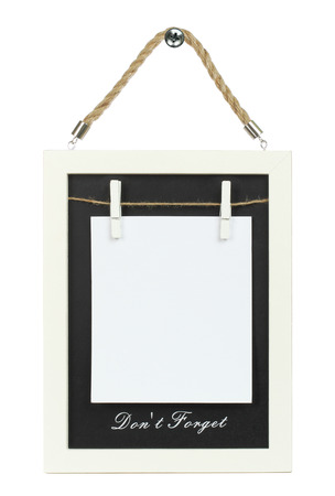 Blank paper on wooden blackboard with a frame, on white background