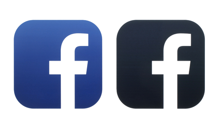 Kiev, Ukraine - October 06, 2016: Facebook and Facebook Mentions icons printed on white paper Editorial